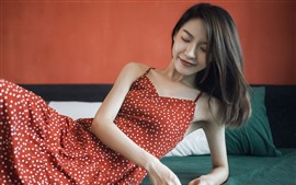 Preview wallpaper Red skirt Asian girl, smile, pose, bed