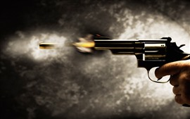 Preview wallpaper Revolver pistol, shoot, bullet, moment