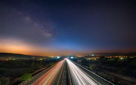 Preview wallpaper Road, light lines, city, starry, sky, night