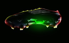 Sapatas do esporte, cores, luz, fundo preto
