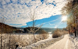 Preview wallpaper Thick snow, trees, road, fields, sun rays, winter