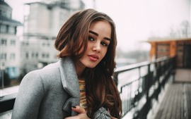 Preview wallpaper Brown hair girl, coat, city, hazy background