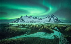 Preview wallpaper Iceland, mountains, grass, northern lights, starry, night