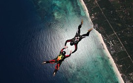 Preview wallpaper Skydivers, parachuting, sea, city, extreme sport
