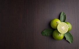 Preview wallpaper Limes, fruit, wood background