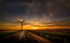 Preview wallpaper Road, fields, windmills, sunset, sky, clouds