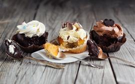 Preview wallpaper Three cupcakes, cream, dessert