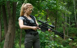 Preview wallpaper Blonde girl, sniper rifle, forest