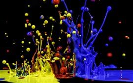 Respingo de tinta azul, amarelo e vermelho