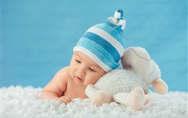 Preview wallpaper Cute baby and toy sheep