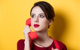 Preview wallpaper Girl use telephone, yellow background