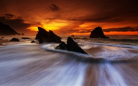 Preview wallpaper Rocks, water stream, sea, red sky, sunset