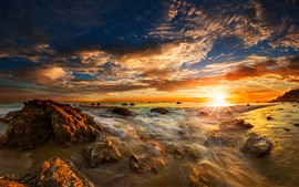 Preview wallpaper Sea, rocks, sun rays, sunrise, dawn, sky, clouds