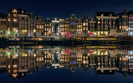 Preview wallpaper Amsterdam, Netherlands, night city, houses, boats, river, lights
