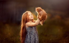 Preview wallpaper Cute little girl and furry kitten