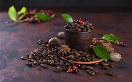 Many coffee beans, cup, green foliage, nuts