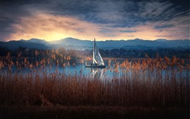 Preview wallpaper Reeds, lake, sailboat, mountains, clouds, morning