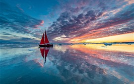 Preview wallpaper Sailboat, sea, clouds, ice, sunset, water reflection