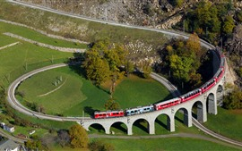Preview wallpaper Switzerland, spiral viaduct, train, village