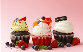 Preview wallpaper Three kinds of cupcakes, strawberry, blueberry, cream