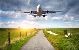Airplane, flight, wings, road, green fields, village, fence, sunshine