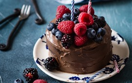 Chocolate cake, berries, candles