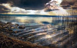 Preview wallpaper Lake, reeds, clouds, dusk, rocks, sun rays
