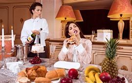 Two girls, lunch, bread, wine, apples, banana