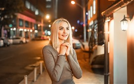 Preview wallpaper Blonde girl, smile, night, lights, city