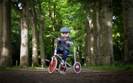 Preview wallpaper Cute little boy, child, toy bike