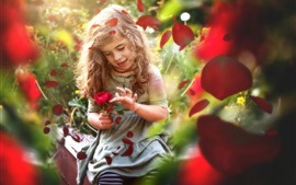 Preview wallpaper Cute little girl and red rose, petals, hazy