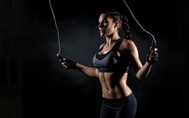 Preview wallpaper Fitness girl, black background, rope skipping