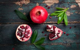 Preview wallpaper Fruit, pomegranate, green leaves