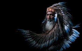 Preview wallpaper Indian, man, feathers, black background