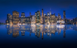 USA, Manhattan, New York, city at night, skyscrapers, lights, river, reflection