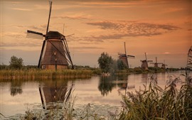 Windmills, river, village