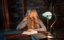 Blonde girl, books, lamp