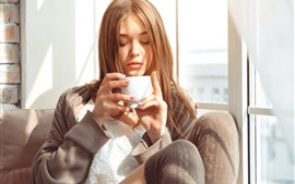 Preview wallpaper Brown hair girl, drink coffee, sunshine, window