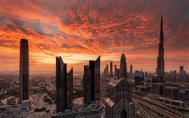 Preview wallpaper Dubai, skyscrapers, red sky, clouds, sunset