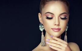 Fashion girl, close eyes, earring, black background