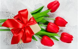Gift and red tulips