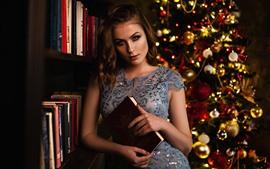 Girl, books, Christmas tree