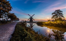 Preview wallpaper Netherlands, windmill, river, fog, morning, lights