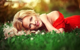 Preview wallpaper Smile blonde girl lying on the grass