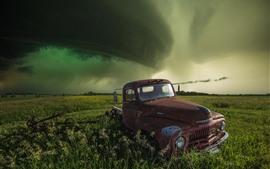 Truck, green fields, clouds, storm