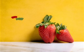 Preview wallpaper Two strawberries, yellow background