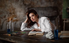 Young girl, books, white shirt