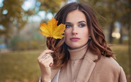 Brown hair girl, maple leaf