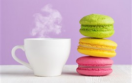 Colorful macaron, white cup, coffee, steam