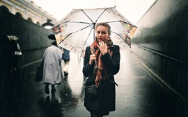 Preview wallpaper Girl in the rain, umbrella, street